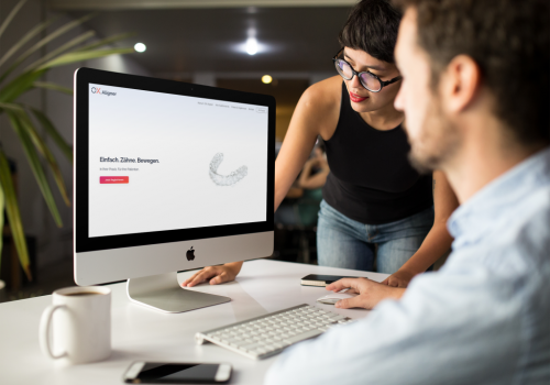 girl-showing-something-in-imac-mockup-to-coworker-a16266